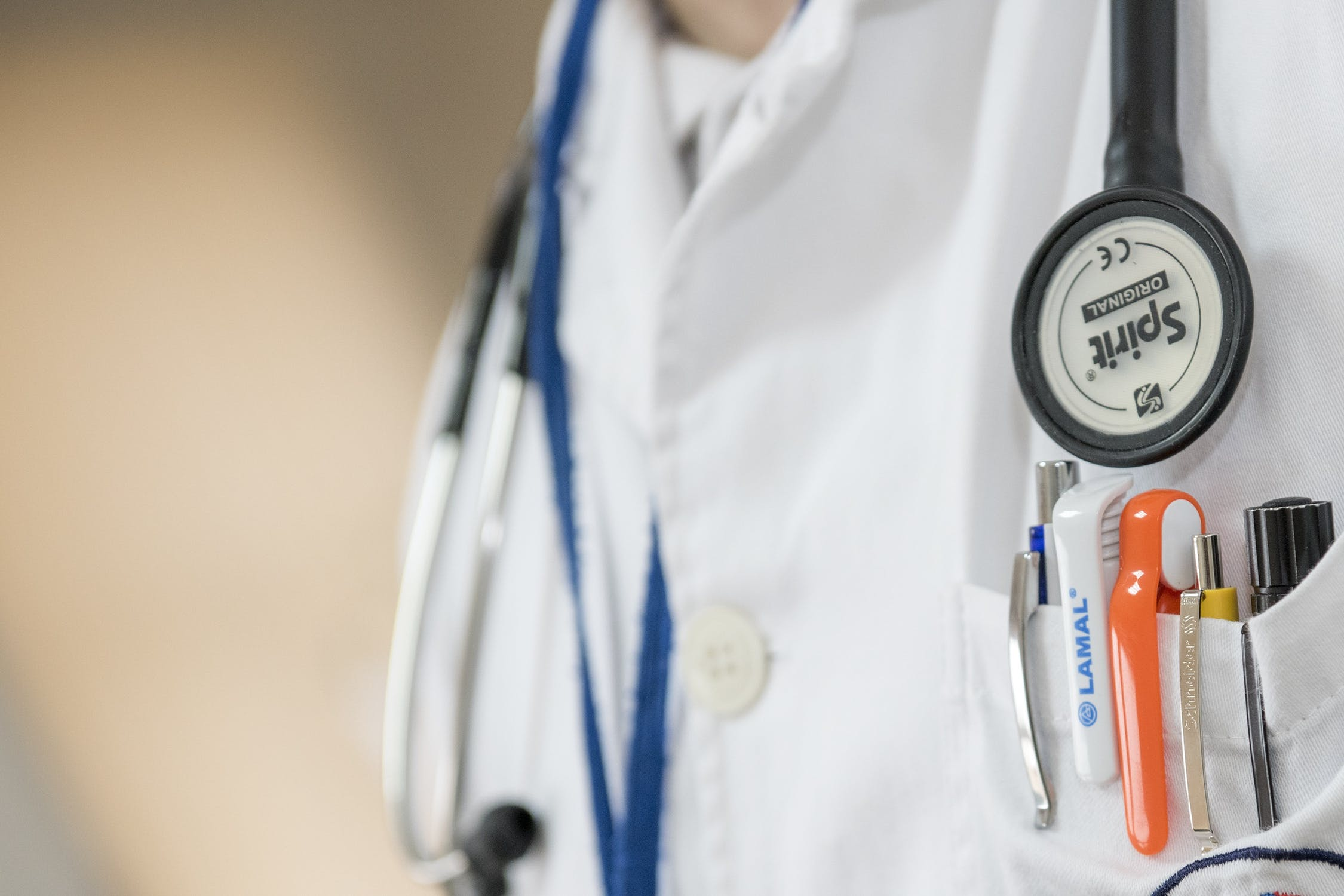 Image of doctors coat with pens in pocket and stethoscope